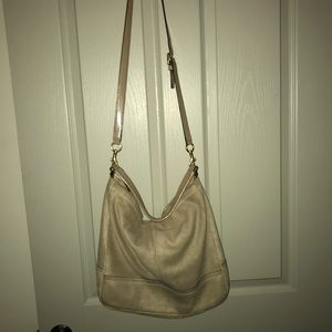Classic gold\nude Coach purse.